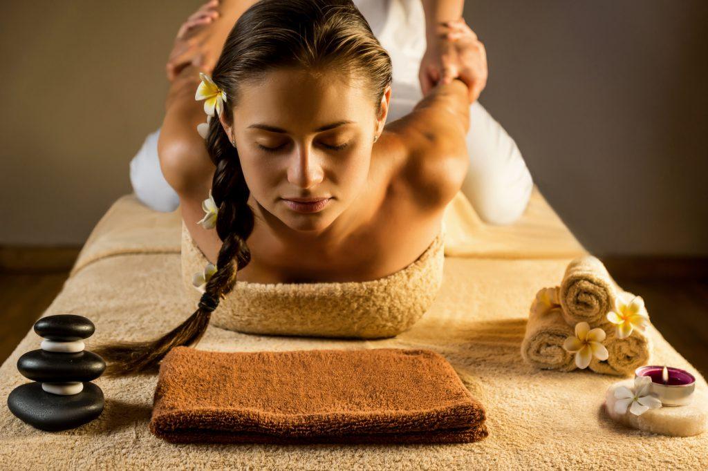 The beautiful girl has massage. Stretching.